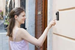 woman ringing the Greet doorbell